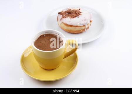 A Cup of Turkish Coffee and a Donut - Stock Photo
