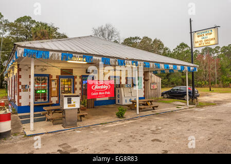 Vintage gas pump and a general store on US Highway 19, near Cedar Key, Florida - Stock Photo