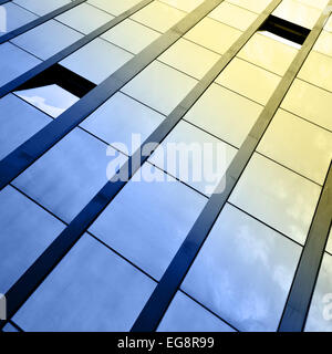 Windows of office building and sky reflection - Stock Photo