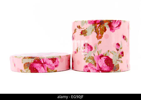 round pink with roses gift box on a white background - Stock Photo