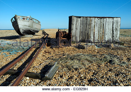 Old fishing boat and hut, along with the railway that was used to transport fish from shore to Hythe. Dungeness, - Stock Photo
