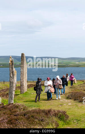 A tour group visiting the Ring of Brodgar on Orkney Mainland. - Stock Photo
