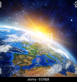 Sunrise over the Earth. Imaginary view of planet earth in outer space with rising sun. Elements of this image furnished - Stock Photo