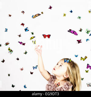 Girl with butterflies on white - Stock Photo