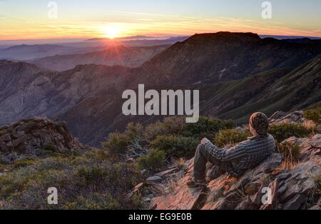 USA, California, Cleveland National Forest, Hiker looking at sunrise - Stock Photo