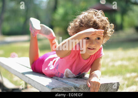 Girl (2-3) playing in park - Stock Photo