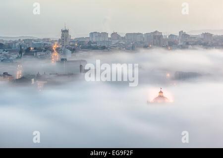 Portugal, Porto, Gaia, Cityscape in fog - Stock Photo