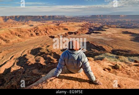 USA, Utah, Canyonlands National Park, Hiker looking at Buck Canyon - Stock Photo
