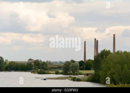London Brick Company factory chimneys next to lake at Stewartby, Bedfordshire, England - Stock Photo