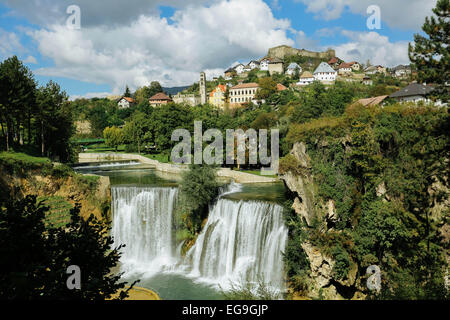Bosnia and Herzegovina, Jajce, Town on hill, waterfall in foreground - Stock Photo