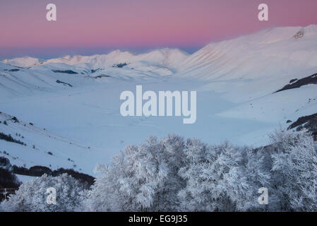 Piano Grande of Castelluccio di Norcia at sunset in winter, Sibillini Mountains National Park, Umbria, Italy - Stock Photo