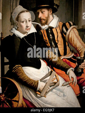 A woman at the spinning wheel and a man with a mug seated in an interior.1560 Pieter Pietersz the Elder Dutch Netherlands - Stock Photo