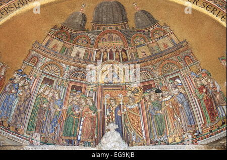 Mosaic in St. Mark Cathedral facade in Venice, Italy. Describes the reception of St. Mark body into the basilica - Stock Photo