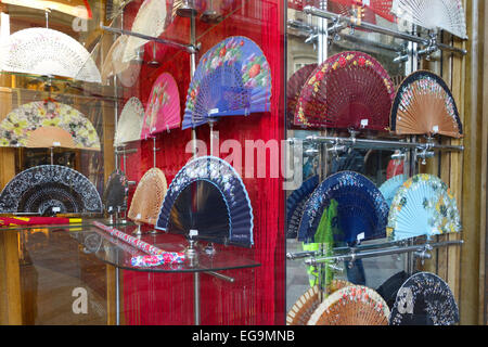 Spanish Hand fans, abanicos ,on display in window, store Madrid, Spain. - Stock Photo