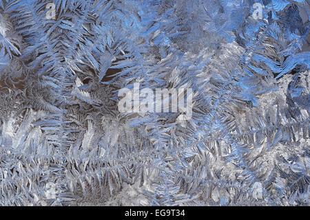 Frozen ice crystals on window pane. - Stock Photo