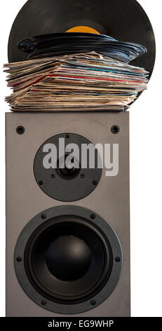 Vinyl records 45 rpm laid on a loudspeaker - Stock Photo