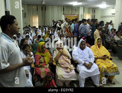 Karachi, Pakistan. 20th Feb, 2015. Paramedical Staffs of Abbasi Shaheed Hospital (ASH) are offering prayer for departed - Stock Photo