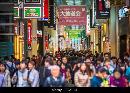 Crowded Shinsaibashi shopping street in Osaka, Japan, Faces defocused - Stock Photo