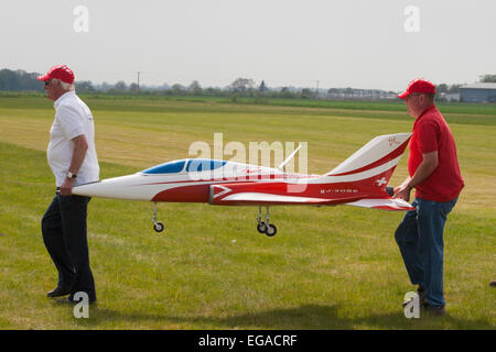 Carrying a large RC model Jet airplane ready for air display - Stock Photo
