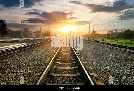 Railroad and small station at the sunset - Stock Photo