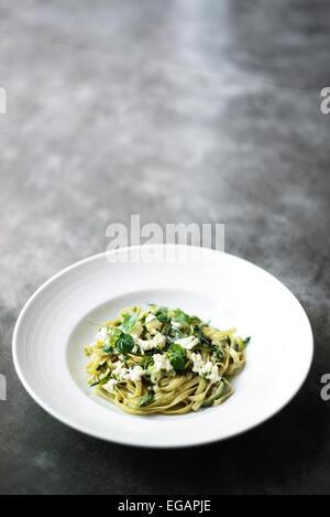 ricotta and herb tagliatelle pasta - Stock Photo