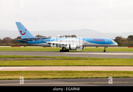 Thomson Boeing 757, taking off from Manchester International Airport. - Stock Photo