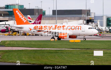 easyJet A319, taking off from Manchester Airport. - Stock Photo