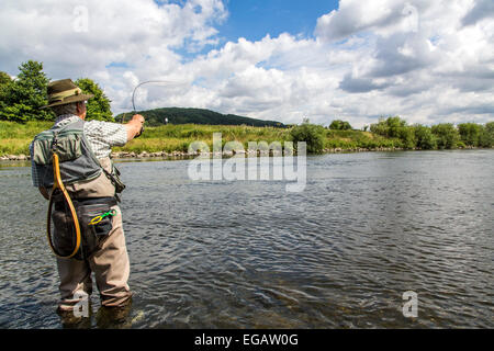 Fly fishing in river Ruhr, Hattingen Germany - Stock Photo