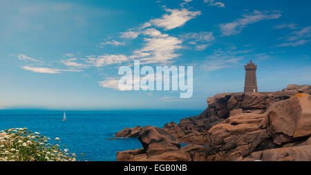Men ruz lighthouse in Brittany France between Ploumanach and Perros Guirec pink granit coast landscape, Blue sky - Stock Photo