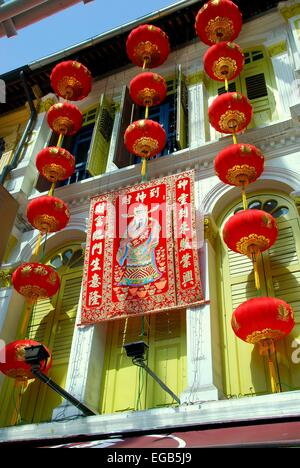 singapore chinese lanterns and a lunar new year banner hang from a building on pagoda