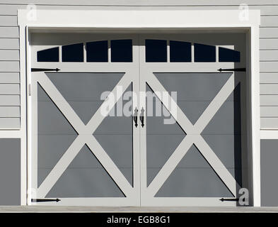 double garage doors with windows. New Wooden Double Garage Doors With Windows On A House. - Stock Photo O