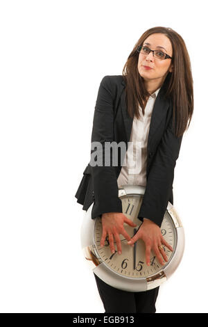 portrait of a beautiful young woman holding a big clock - Stock Photo