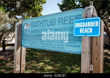 Florida, Stuart, Hutchinson Barrier Island, Bathtub Reef Beach, sign, logo, unguarded, sightseeing visitors travel - Stock Photo