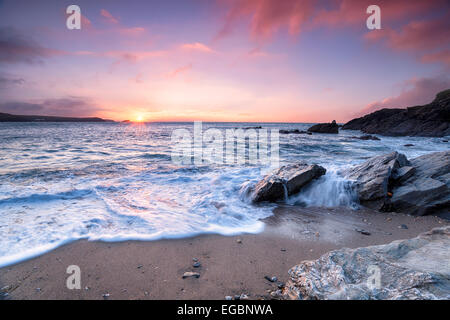 Beautiful dramatic ocean sunset at Little Fistral Beach in Newquay, Cornwall - Stock Photo