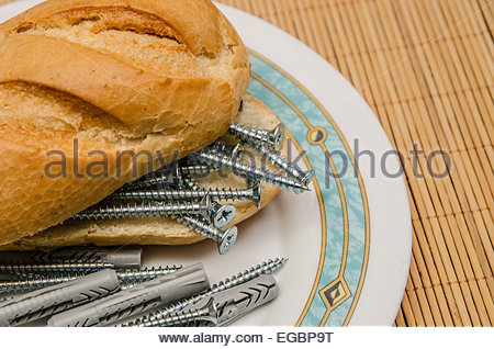 A sandwich made with screws and dowels - Stock Photo