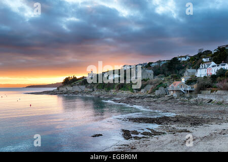 Dusk over Tavern beach at St Mawes near Falmouth in Cornwall - Stock Photo