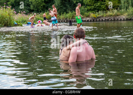 People take a bath, on a hot summer day, in river Ruhr - Stock Photo
