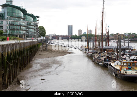 Boats moored up at Hermitage Wharf on the River Thames in London. - Stock Photo