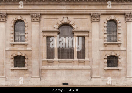 St Martin-in-the-Fields carries a gynaecological reworking of Christian symbols outside - Stock Photo