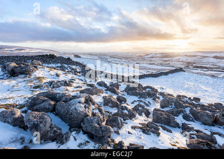 Sunset over a snow covered Ribblesdale in the Yorkshire Dales National Park - the view from Pen-y-ghent.