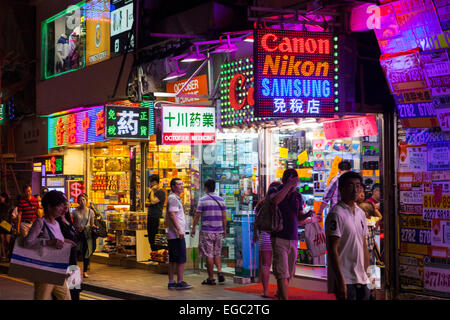 a street at night in Kowloon, Hong Kong - Stock Photo