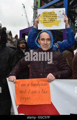 London, UK. 22nd February, 2015. A group of ordinary people Romanians holds a silents protest against Channel 4 - Stock Photo