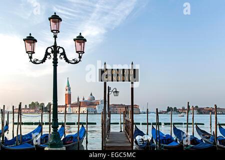 Gondolas dock, lamp post and San Giorgio Maggiore Church, Venice, Italy - Stock Photo