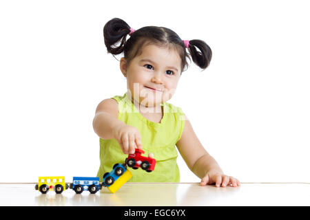 Cute little girl playing trains - Stock Photo