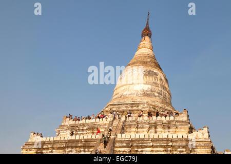 Tourists climbing the Shwe-San-Daw Pagoda to watch the sunset, Bagan, Myanmar ( Burma ), Asia - Stock Photo