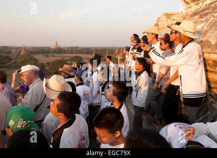 Tourists watching the sunset from a temple, Bagan, Myanmar ( Burma ), Asia - Stock Photo