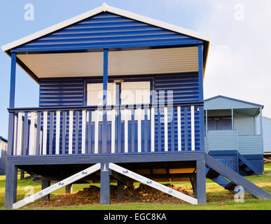 colourful wooden beach huts overlooking the sea at Tankerton near Whitstable Kent - Stock Photo