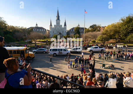 Street performance gathers a crowd of tourists in the French Quarter of New Orleans. - Stock Photo