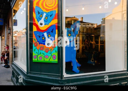 Blue Dog paintings and installations by George Rodrigue in a gallery on Royal Street, New Orleans - Stock Photo