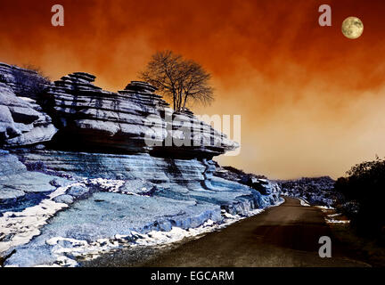 Infrared Image of the Moon rising over road through  El Torcal,  Antequera, Malaga Province,  Andalucia, Spain - Stock Photo